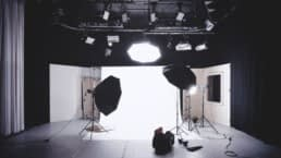Video production studio with 3 softbox lights prepared for a business video production shoot.