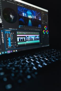 Video editing software being used to produce a business marketing video.